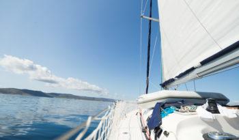 Portrait of sailing sport boat on open sea